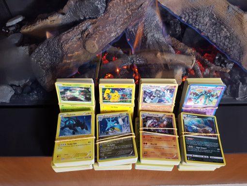 Pokemon Kaarten Set - Een zelfs amengestelde set met 50 kaarten, met in ieder geval één en soms twee holo kaarten, exclusief reverse holo's!